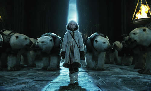 A girl walks through a large, cold, indoor space with polar bears behind her