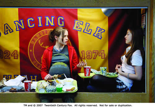 A pregnant teenage girl and her friend sit eating fast food