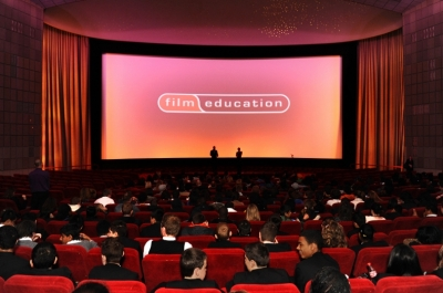 A cinema auditorium with a Film Education logo on the screen