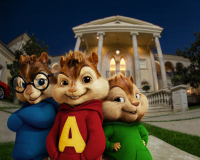 Three animated chipmunks stand in the foreground with a large house behind them