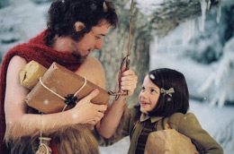 Still of a Faun talking to a little girl