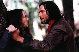 Still of a man holding a woman against a tree
