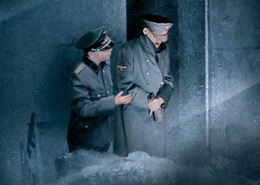 Still of two men in uniform standing in the snow