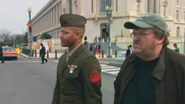 Still of a man standing with a U.S. Soldier on the street