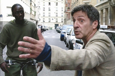 Man pointing to another man on a bicycle