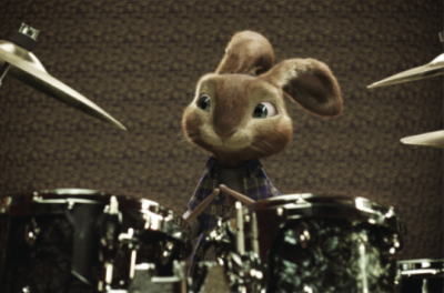 An animated bunny rabbit sits behind a drum kit
