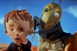 An animated image of a boy looking through a magnifying glass next to a grasshopper