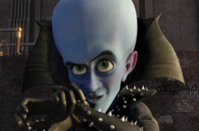 A close up of a blue, animated character talks into a device on his wrist