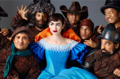 A young woman in a blue dress with seven dwarves standing around her