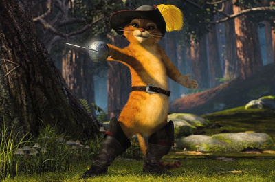 An animated cat in boots and a hat stands in a wood with his sword drawn