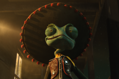 Lizard stands in sombrero and cowboy outfit.