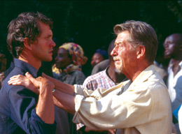 Still of a man standing with his hands on another man's shoulders