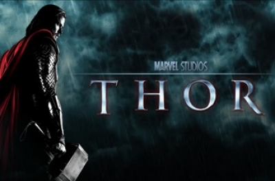 Poster image from Thor showing a man in armour and a red cape holding a large hammer.