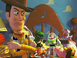 Animated image of a toy cowboy on a bed with a variety of other toys