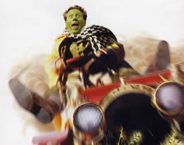 A man with green face paint driving a car at a high speed