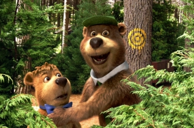 Two CGI bears stand in the woods