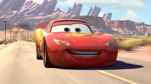 An animated car drives down a road