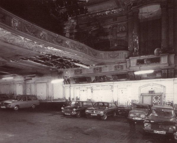 Photograph of an old cinema being used as a car showroom