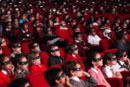 Children in a cinema wearing 3D glasses