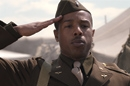 A young black World War II soldier saluting