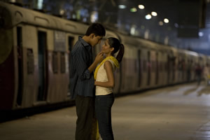 Lead characters Latika and Jamal in an embrace at VT station