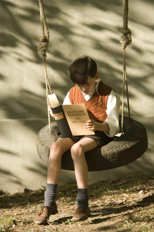 film education resources the boy in the striped pyjamas  still image from the boy in the striped pyjamas bruno reading on the swing